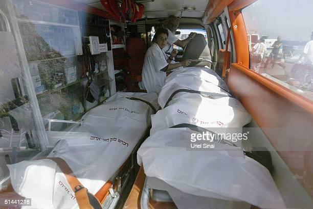 The bodies of victims taken from the scene of three bomb blasts at Egyptian holiday resorts are brought by ambulance across the border into Israel on...