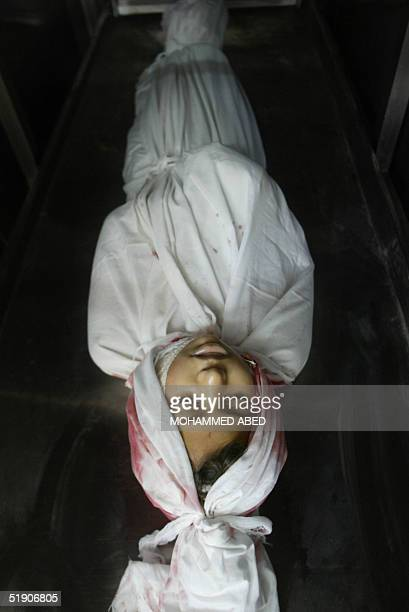 The body of 10yearold Palestinian Ibtihal Abu Daher lies in a hospital morgue at the Jabalia refugee camp 01 January 2005 The girl was killed while...