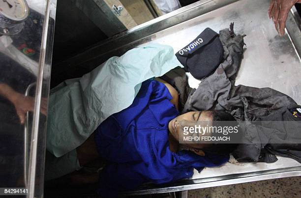 The body of a 13yearold Palestinian boy is seen at the morgue of alShifa hospital in Gaza City on January 14 2008 Israel carried out a fresh wave of...