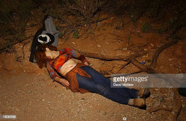 The body of a 24 yearold woman lies in a wash where she died in the heat of the Sonoran Desert after crossing the US/Mexico border July 31 2001 on...