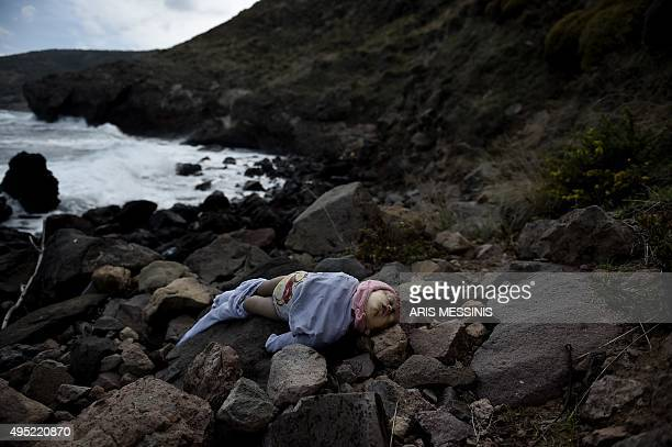 The body of a baby lies on a beach on the Greek island of Lesbos on November 1 after boats transporting migrants and refugees trying to cross the...