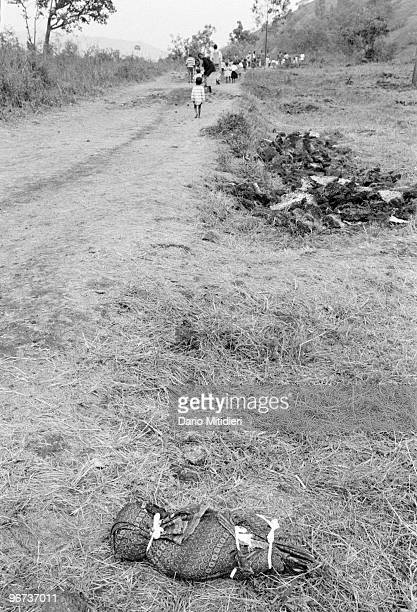 The body of a child who survived the 1994 Rwandan genocide but later died following a deadly outbreak of cholera is left for collection on the side...
