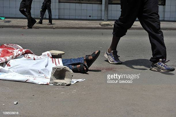 The body of a civilian who was killed on February 21 2011 lies on a street of Treichville in Abidjan in clashes between forces loyal to outgoing...
