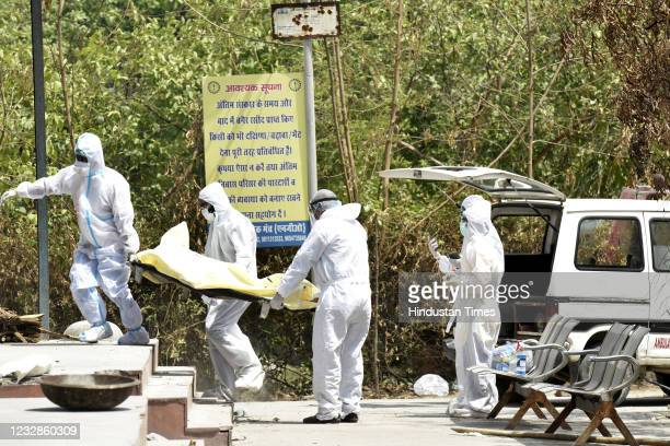 The body of a Covid-19 victim being carried for cremation at Sector 94 crematorium, on May 12, 2021 in Noida, India.