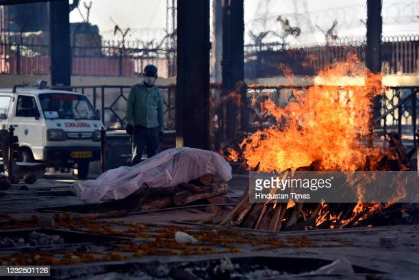 The body of a Covid-19 victim laid for cremation, at Nigambodh Ghat crematorium, on April 24, 2021 in New Delhi, India.