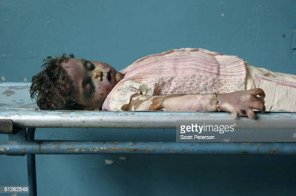 The body of a dead child one of 330 known dead lies in the city mortuary the day after the threeday Russian school siege in Beslan in which Chechen...