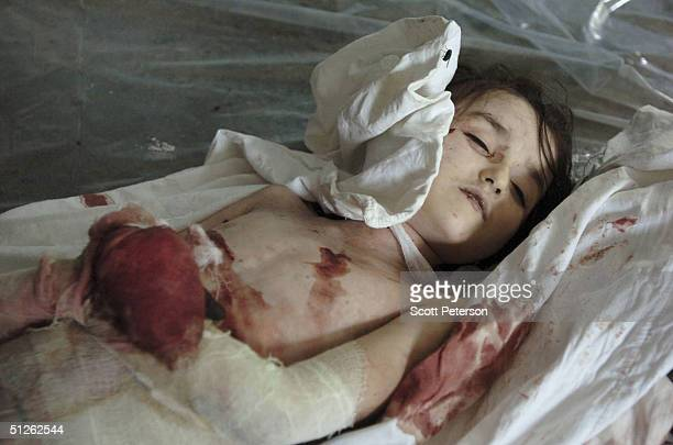The body of a dead girl one of 330 known dead lies in the city mortuary the day after the threeday Russian school siege in Beslan in which Chechen...