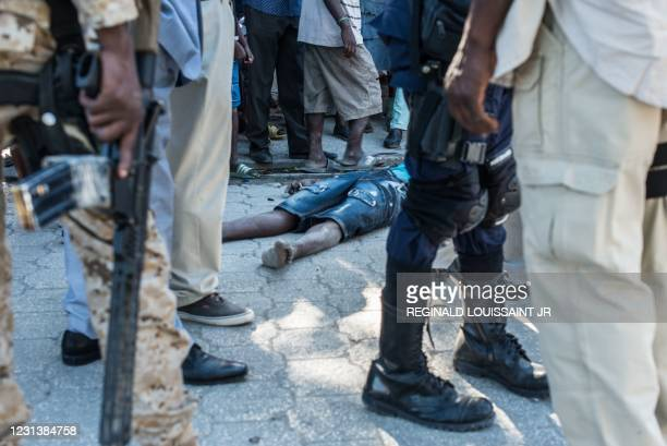 The body of a dead inmate lies on the pavement by the Croix-des-Bouquets prison from where many prisoners escaped and where several people were...