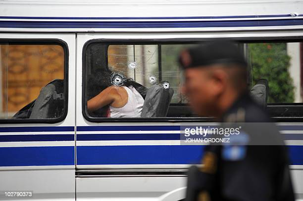 The body of a dead woman remains on the seat of a microbus attacked by gangsters whilst returning from a men's prison in downtown Guatemala City July...
