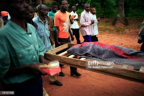 The body of a diseased child is to a nearby cemetery from a makeshift camp on December 6, 2005 in Dubie, Katanga Province in Congo, Democratic...