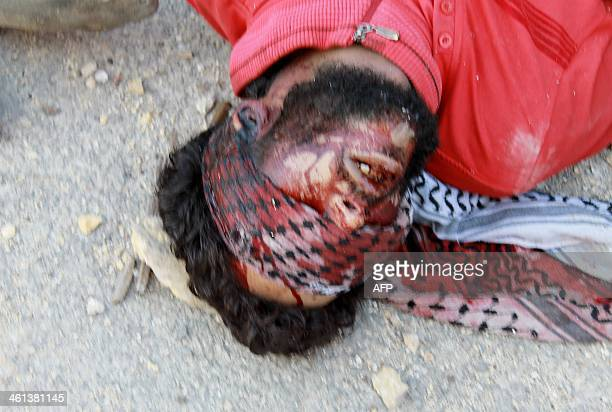 CONTENT The body of a handcuffed and blindfolded dead man lies on the ground of the Aleppo headquarters of the Islamic State of Iraq and the Levant...