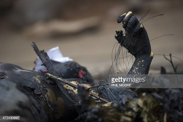 The body of a man claimed to be Imbonerakure a member of the youth wing of the ruling CNDDFDD party lies burned in the Nyakabiga neighbourhood of...