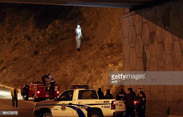 The body of a man hangs from a bridge in Tijuana northwest Mexico in the border with the US on October 17 2009 Some 14000 people have been killed in...