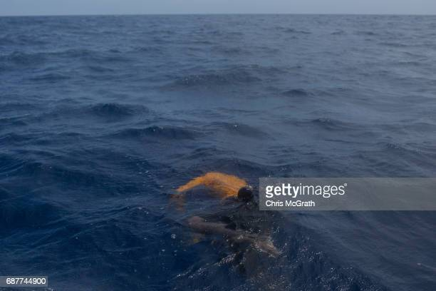 The body of a man is seen floating in the water after rescue crews from the Migrant Offshore Aid Station 'Phoenix' vessel collect bodies of those...