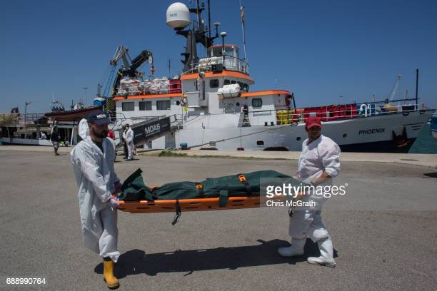The body of a mirgant that died at sea attempting to reach Italy on May 24th is carried by crewmembers of the Migrant Offshore Aid Station 'Phoenix'...