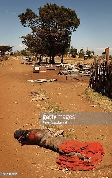 CONTENT The body of a murdered Kikuyu man lies in the village of Rurigi on January 6 2008 near Eldoret Kenya All of the houses belonging to Kikuyu...
