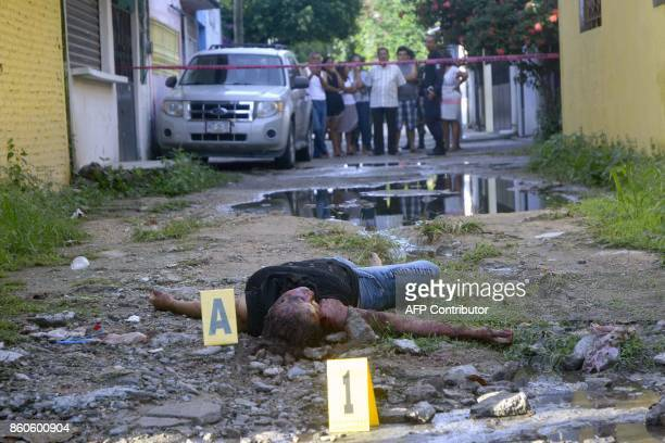 TOPSHOT The body of a murdered woman lies on the crime scene in the Renaissance City neighborhood in the touristic city of Acapulco Guerrero state...