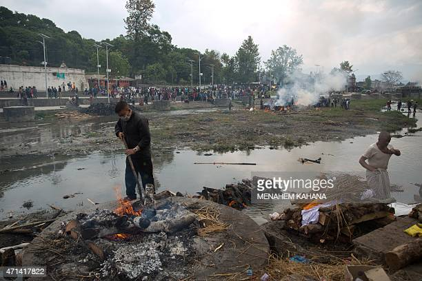The body of a nineyearold boy is prepared for a cremation ceremony next to the Pashupatinata temple in Kathmandu on April 28 2015 Hungry and...
