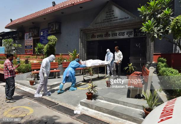 The body of a person who died of Covid-19 is brought for cremation to Nigambodh Ghat crematorium on April 14, 2021 in New Delhi, India. The virus has...