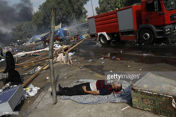The body of a pro-Islamist protester lies on a blanket on the ground during clashes that broke out as Egyptian security forces moved in to disperse...