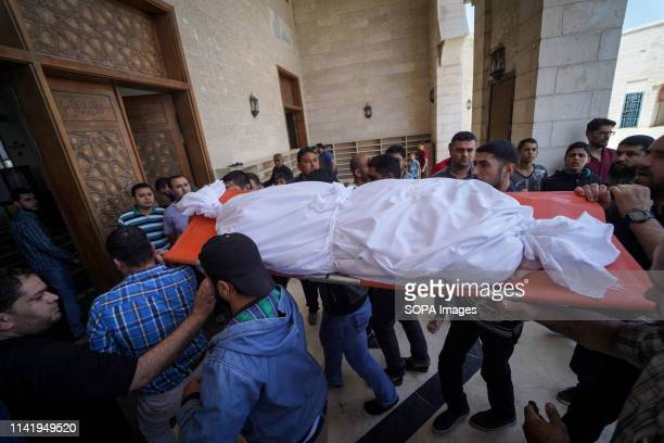 The body of a relative to the deceased seen during the funeral of Maria alGazali a fourmonthold Palestinian baby who was martyred in an Israeli raid...