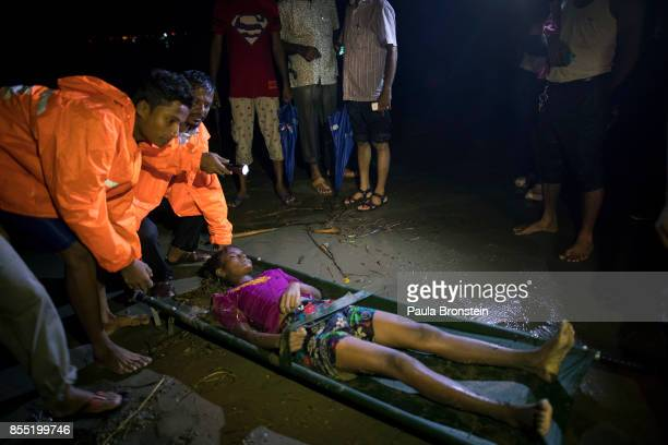 The body of a Rohingya woman is taken away after she washed up after a boat sunk in rough seas off the coast of Bangladesh carrying over 100 people...