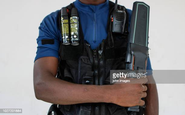 the body of a security guard - metal detector stock photos and pictures