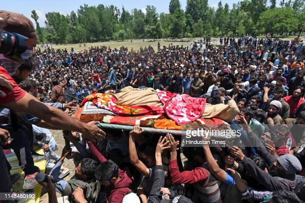 The body of a slain local militant is carried during his funeral procession at Panjran Lassipora area on June 7 2019 in Pulwama India Four...