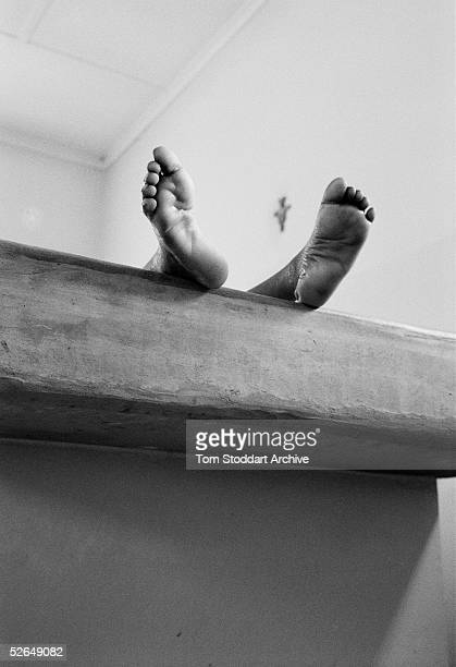 The body of a small boy lies in a morgue in Lusaka Zambia as another African child becomes a tragic AIDS statistic It is estimated that 254 million...