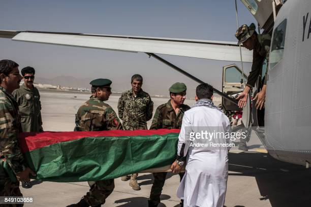 The body of a soldier in the Afghan National Army who was killed in fighting in Urozgan is secured inside an Afghanistan Air Force plane on September...