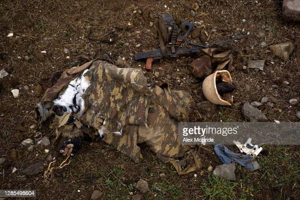 The body of a soldier who had been killed fighting for Azerbaijan lie on the side of the road where the final days of battle had unfolded between...