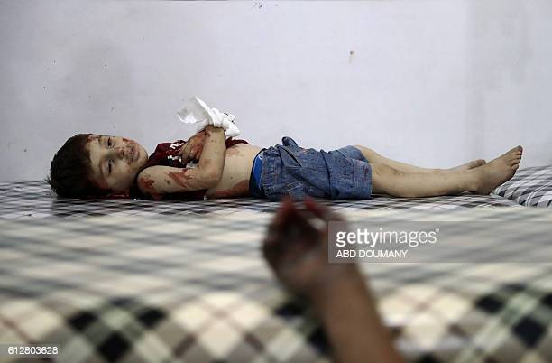 TOPSHOT The body of a Syrian child is seen at a makeshift hospital following reported air strikes on the rebelheld town of Douma on the eastern...