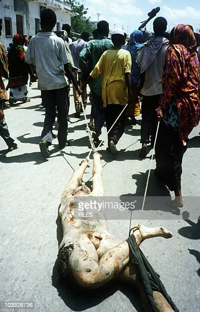 The body of a US soldier is dragged with ropes 03 October 1993 through the streets of Mogadishu Somalia by supporters of fugitive warlord Aidid AFP...