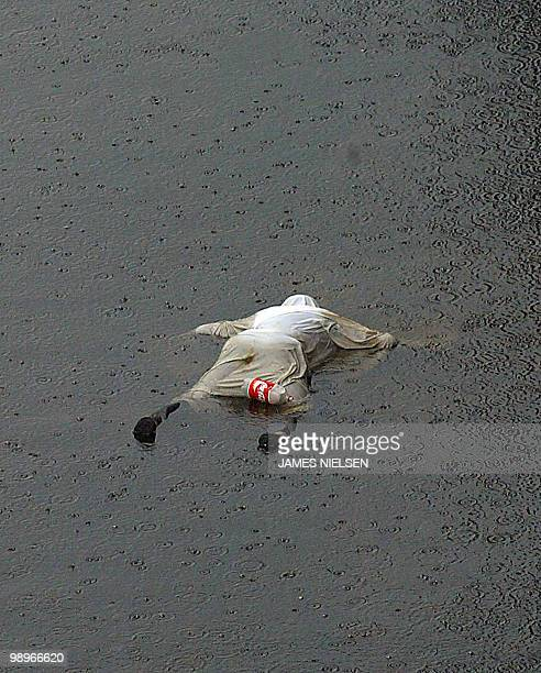 The body of a victim of Hurricane Katrina floats in floodwaters in New Orleans 01 September 2005 Up to 300000 survivors from the hurricane may still...