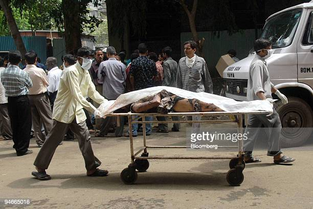 The body of a victim of the July 11 bombings in Mumbai is taken to a morgue for autopsy and official identification in Mumbai India Wednesday July 12...