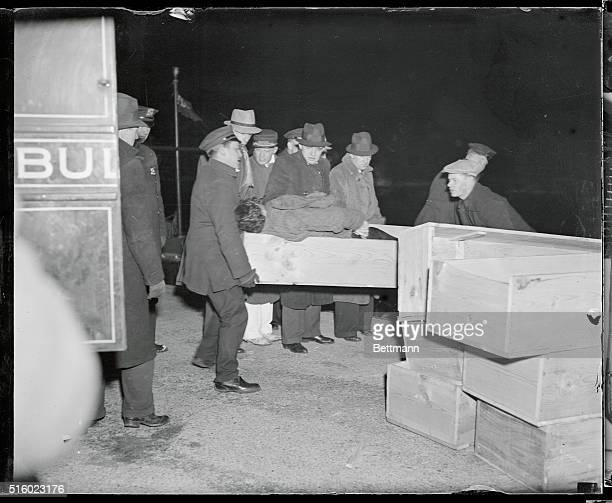 The body of a victim of the Mohawk disaster is shown being taken from an ambulance following its arrival at the Bellevue Hospital morgue at the East...
