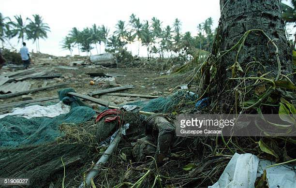 The body of a woman lies among the debris December 31, 2004 in Galle, Sri Lanka. The death toll from the December 26 tsunami that killed more than...