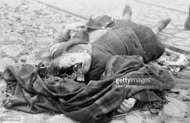 The body of a woman lying in a street in Nazioccupied Poland A photo from an album documenting German atrocities in occupied Poland during World War...