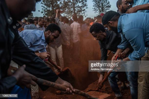 The body of Abdalla Mohamed Dahir is buried on January 16 2018 in Nairobi Kenya Dahir and his colleague were killed after AlShabab militants stormed...
