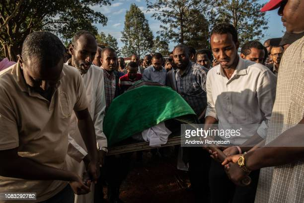 The body of Abdalla Mohamed Dahir is moved during a burial ceremony on January 16 2018 in Nairobi Kenya Dahir and his colleague were killed after...
