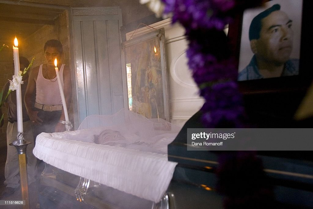The body of Abel Garcia Luis is displayed at an open wake in his family home on March 29, 2007 in the town of San Pablo Huixtepec. Abel died at age 47 from a heart attack while working in California where he lived for the past 20 years. His family in Mexico collected money for his body to be shipped home and buried in his hometown. Over 80% of the working-age men in town migrate to the U.S. leaving behind women, children and elderly. Families of migrants fear that they will never see their relatives again and that they will die on foreign soil. Caskets are shipped daily from the U.S. to Mexico.