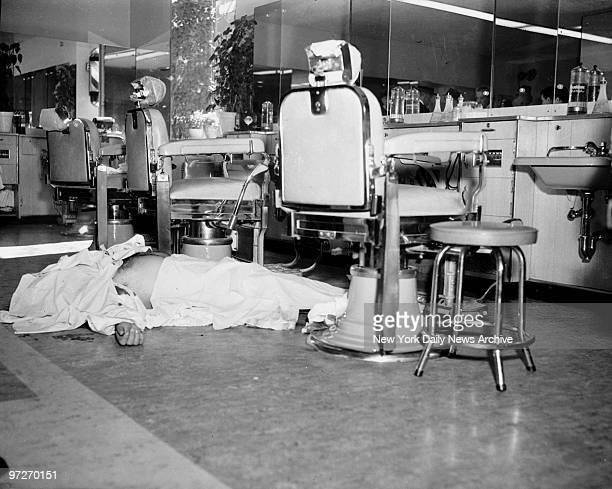 The body of Albert Anastasia reputed chief executioner of Murder Inc lies on the barbershop floor of the ParkSheraton Hotel on W 55th St at 1018 AM...