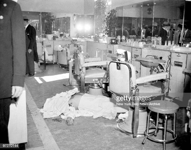 The body of Albert Anastasia who ran Murder Inc a gang of hired killers for organized crime in the late 1930s lies on the barbershop floor at the...