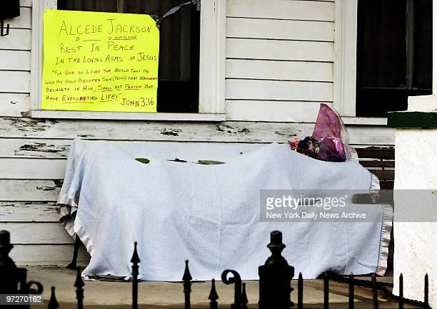 The body of Alcede Jackson lies covered on a front porch in the Garden District neighborhood of New Orleans Six days after Hurricane Katrina ravaged...