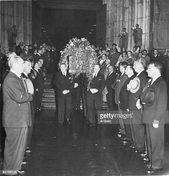 The body of American baseball player Babe Ruth is carried in a casket from St Patrick's Cathedral as New York City Mayor William O'Dwyer and New York...