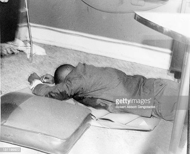 The body of American politician 24th Ward Alderman Benjamin F Lewis assassinated in his office the previous evening lies under his desk Chicago...
