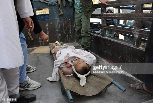 The body of an Afghan civilian killed in a bomb attack lies in the back of a vehicle in Kabul on October 92015 At least one civilian killed and three...