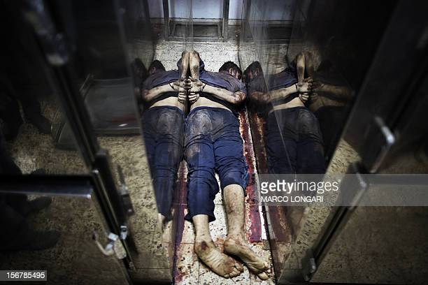 The body of an alleged collaborator lies in between fridges inside a hospital's morgue in Gaza City November 21 2012 Gunmen executed six...