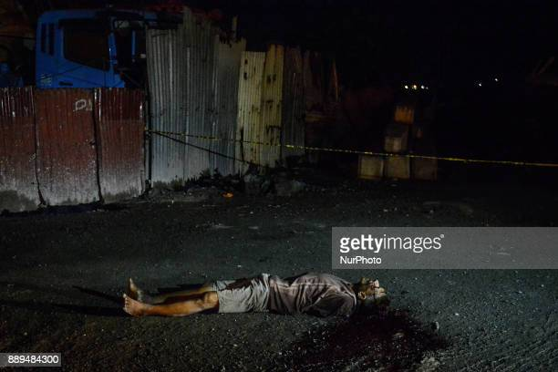 The body of an alleged drug user lies dead after being shot by unidentified assailants in Navotas Metro Manila Philippines July 26 2017 On...