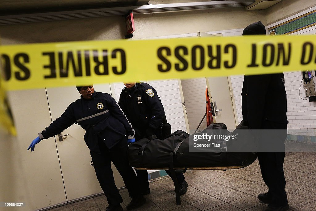 The body of an apparent suicide victim is brought up from a subway station in Times Square on January 22, 2013 in New York City. New York City has been experiencing a rash of incidents involving individuals being hit by trains in suicides, accidents and people being pushed to their deaths.